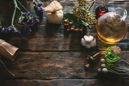 Herbal medicine essential oil on a table. Witchcraft background with copy space. 版權商用圖片