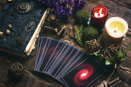 Tarot cards and book of magic on a wooden table background. Future reading. 写真素材