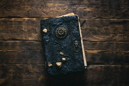 Ancient magic book on a wooden table background. Spellbook. 写真素材