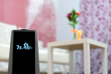 Air humidifier is moisturizing a living room.