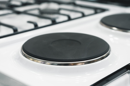 Modern electric stove surface close up background.