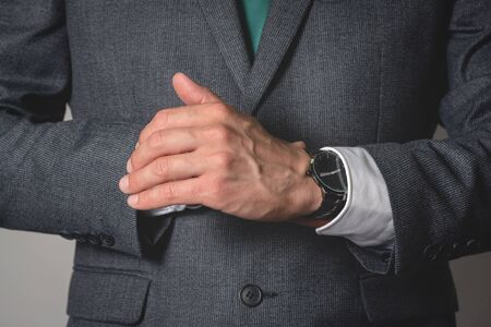 Businessman is wearing a wrist watch close up. Stock fotó