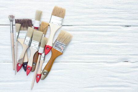 Paintbrushes on a white board background with a copy space.