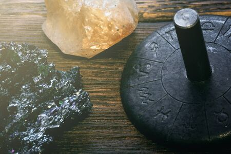 Zodiac wheel and magic stones on a table. Horoscope.