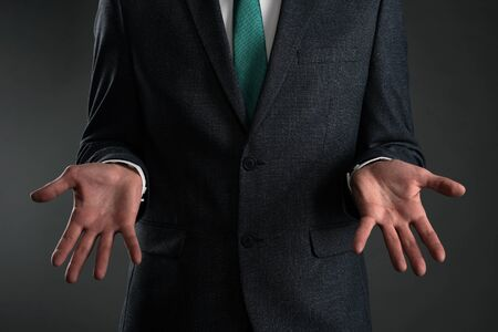 A guilty business man is spreading his arms and make excuses. Business problem. Business misunderstanding. Stockfoto