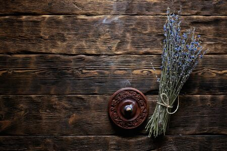 Dried lavender flower branch on a wooden table background with copy space. Herbal medicine concept. 写真素材