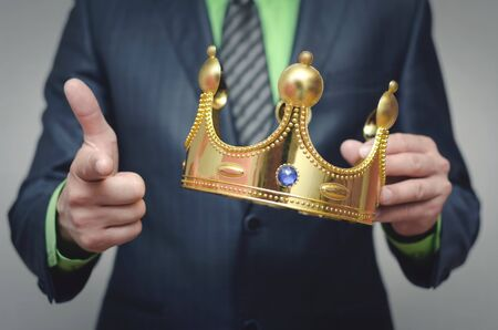 Award ceremony of the Winner. You win. Time to rule concept. Power of authority. Crown for new king. Stock Photo