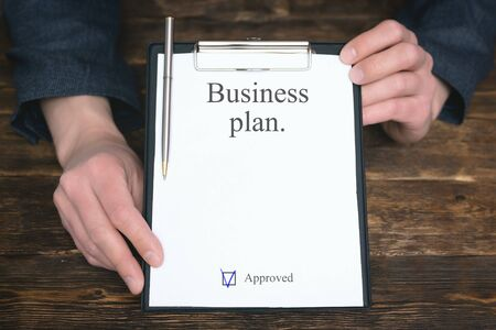 Business plan template. Businessman is showing a blank business plan document.