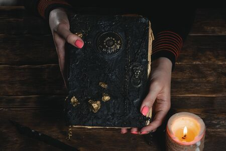 Book of magic in a magician hands. Witchcraft.