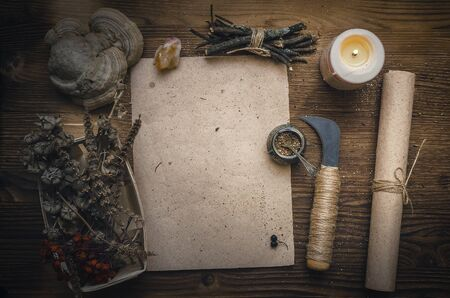 Magic potion ancient recipe scroll with copy space. Alternative herbal medicine. Shaman table with copy space. Druidism concept. Witch doctor desk background.