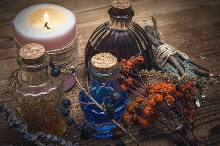 Magic potion. Alternative herbal medicine. Shaman table with copy space. Druidism concept. Witch doctor desk background.