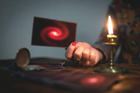 Tarot cards and a woman fortune teller. Future reading concept. Divination. Foto de archivo