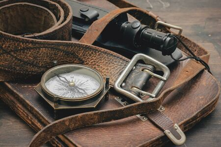 Old travel equipment and adventurer accessories on the wooden table flat lay background. Zdjęcie Seryjne