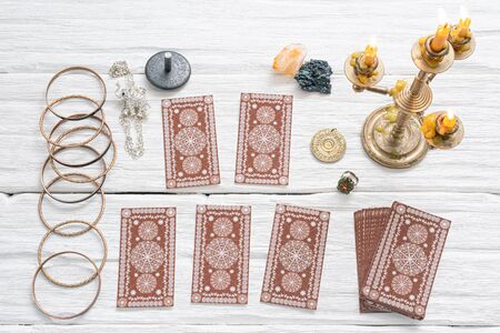 Tarot cards on white table of fortune teller. Divination. Future reading concept.