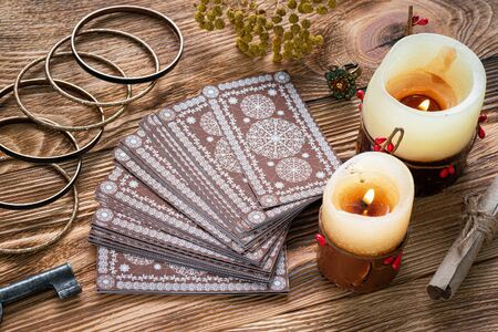 Tarot cards on brown table of fortune teller. Divination. Future reading concept.