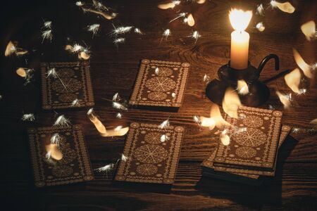 Tarot cards on the table and mystic light around concept.