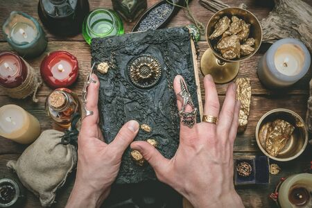 Alchemist producing gold from the stones on his magic table concept.