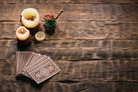 Tarot cards on the wooden table background.