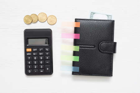 Calculator and wallet.