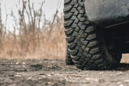 Mud terrain wheel of car close up background.