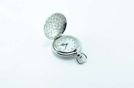 Old vintage open silver pocket watch isolated on white background. Imagens