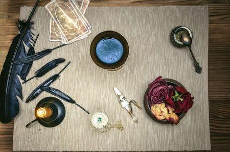 Tarot cards deck on fortune teller magic desk table. Future reading.