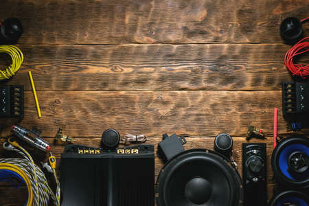A new car audio equipment on brown wooden workbench background with copy space. Stock Photo