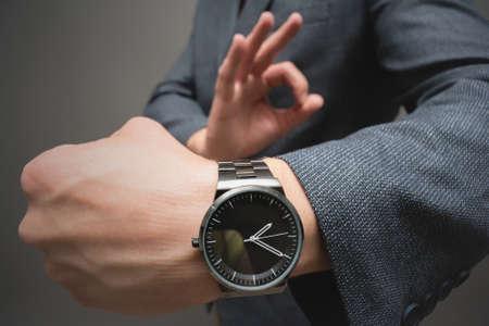 A wrist watch on the businessman hand close up. Фото со стока
