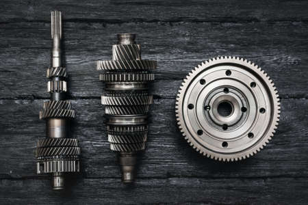 Primary and secondary shaft of the car gearbox on black background.