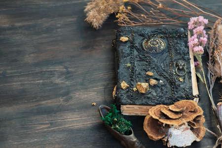 Magic book on the magic table background. Foto de archivo