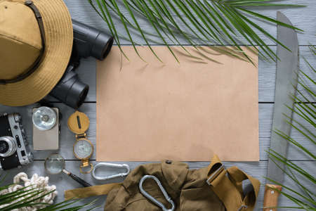 Treasure map mockup. Tourist equipment on the table flat lay background.