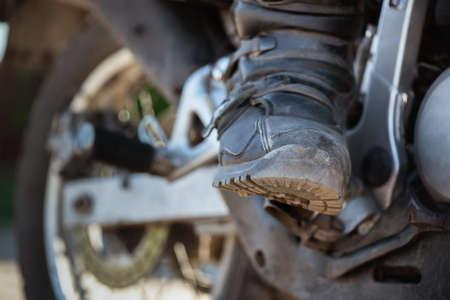 Motor biker boots close up background. Фото со стока