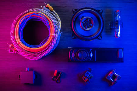 A car audio equipment on the table in the neon lights background. Stockfoto