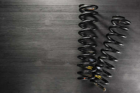 A car coil springs on the workbench background with copy space.