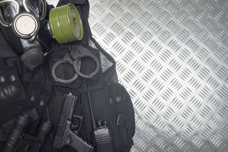 An airsoft equipment on the metal background with copy space.