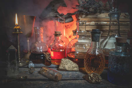 Magic potions on the alchemist table background.