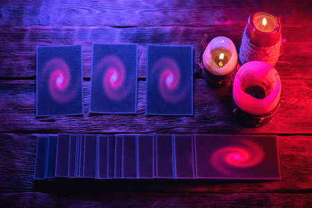 Tarot cards on the future reader table background.