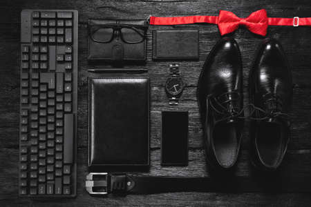 Business accessories on the black table flat lay background.