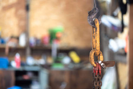Small construction hook on the background of the workshop close up.
