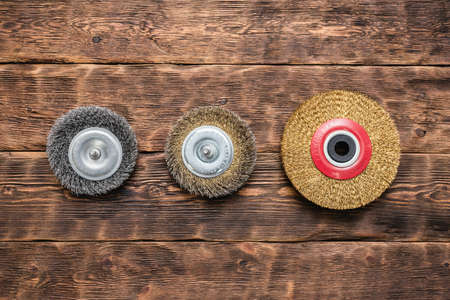 Various grinding discs on the wooden workbench flat lay background.