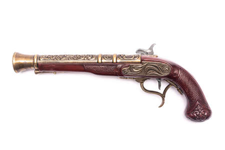 Ancient musket gun isolated on the white background.