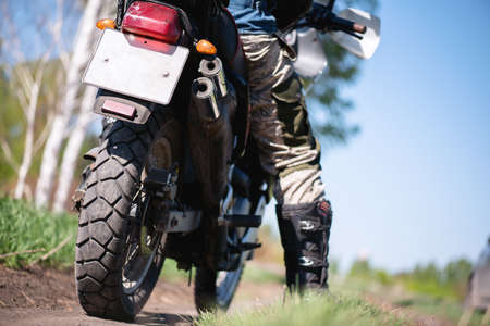 Motor biker on the countryside road close up.