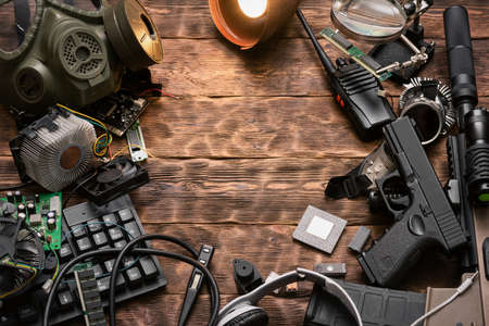 Post apocalypse survivor equipment on the brown wooden table background with copy space.