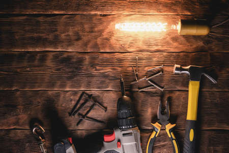 Construction tools on the workbench flat lay background.