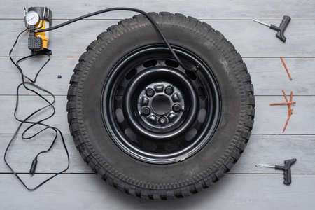 Tire fitting service concept flat lay background.