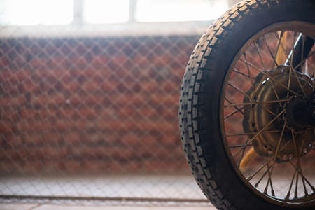 Old motorcycle wheel close up background.
