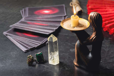 Tarot cards on the old table background. Future reading concept.