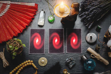Tarot cards on the old black table background. Future reading concept.