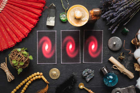 Tarot cards and magical accessories on the old table background. Future reading concept.