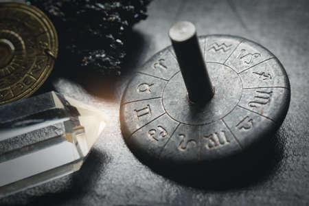Horoscope zodiac wheel on the table close up. Gemini sign.